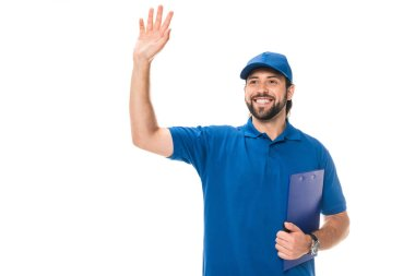 Happy young delivery man holding clipboard and waving hand isolated on white stock vector