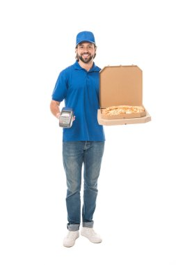 handsome delivery man holding pizza in boxes and payment terminal, smiling at camera isolated on white
