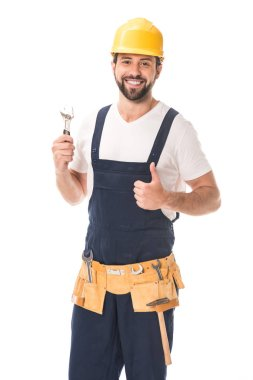 Handsome happy workman holding wrench and smiling at camera isolated on white stock vector