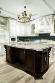 interior of modern kitchen with comfortable furniture in baroque style
