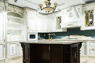 interior of modern kitchen with comfortable wooden furniture in baroque style
