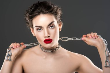 sexy woman with chain on neck, isolated on grey