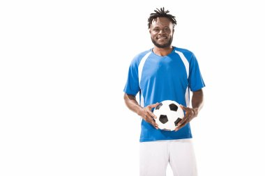 Happy african american sportsman holding soccer ball and smiling at camera isolated on white stock vector