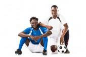 Fotografie Happy afrických amerických fotbalistů se usmívá na fotoaparát izolované na bílém