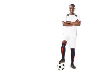 Confident young african american soccer player standing with crossed arms and smiling at camera isolated on white stock vector