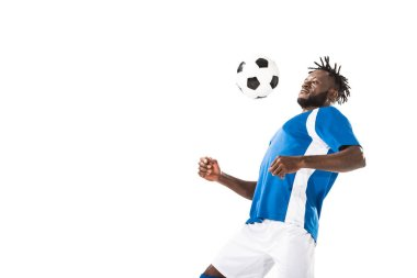 Athletic young african american soccer player hitting ball with chest isolated on white stock vector
