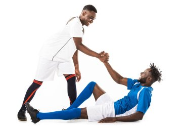 happy young african american sportsman helping soccer player isolated on white
