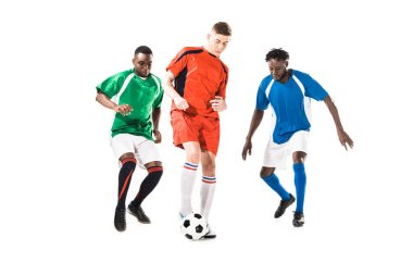 Three multiethnic sportsmen playing with soccer ball isolated on white stock vector