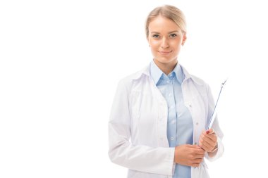 smiling young female doctor with clipboard looking at camera isolated on white