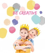 Fotografie sister hugging brother, kids in yellow paper crowns, isolated on white with be creative inspiration