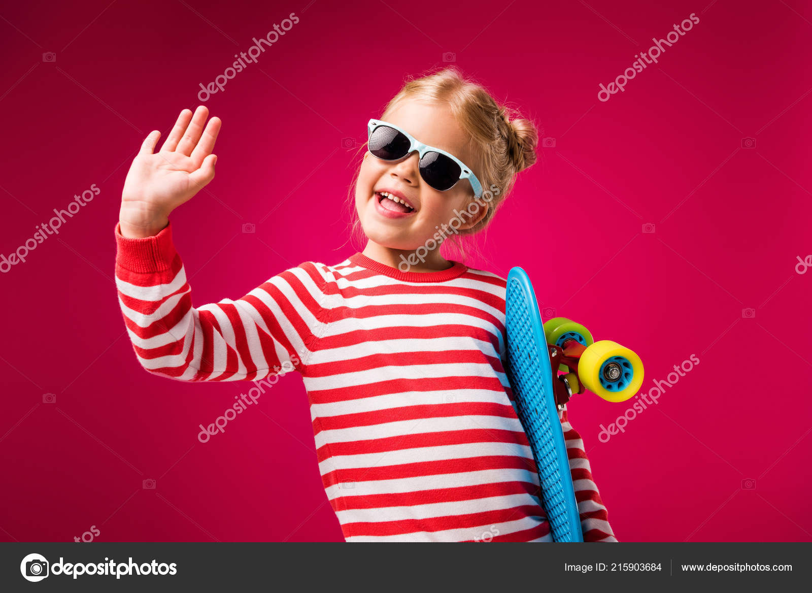 ff9dc642e4af Excited Stylish Kid Sunglasses Holding Penny Board Waving Isolated Red —  Stock Photo