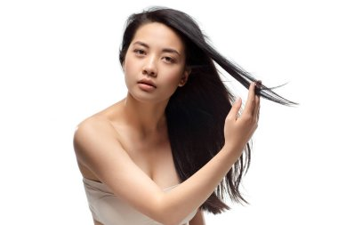 Portrait of asian model with healthy and shiny hair posing isolated on white stock vector