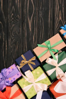 top view of wrapped christmas gifts on wooden surface