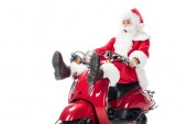 Fotografie shocked santa claus in costume riding on scooter isolated on white background
