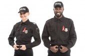 Photo confident multiethnic police officers with aids awareness red ribbons looking at camera isolated on white