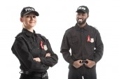 Photo smiling police officers with aids awareness red ribbons isolated on white
