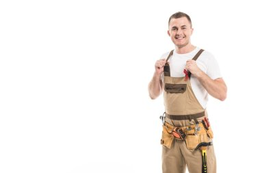 handsome adult builder with aids awareness red ribbon on overall looking at camera isolated on white