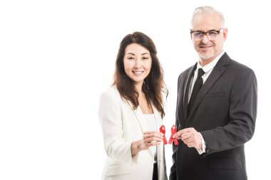 multiethnic adult businesspeople holding aids awareness red ribbons isolated on white