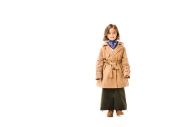 Beautiful little child in trench coat standing and looking at camera isolated on white stock vector
