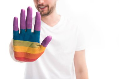 cropped image of homosexual man showing hand painted in colors of pride flag isolated on white, world aids day concept