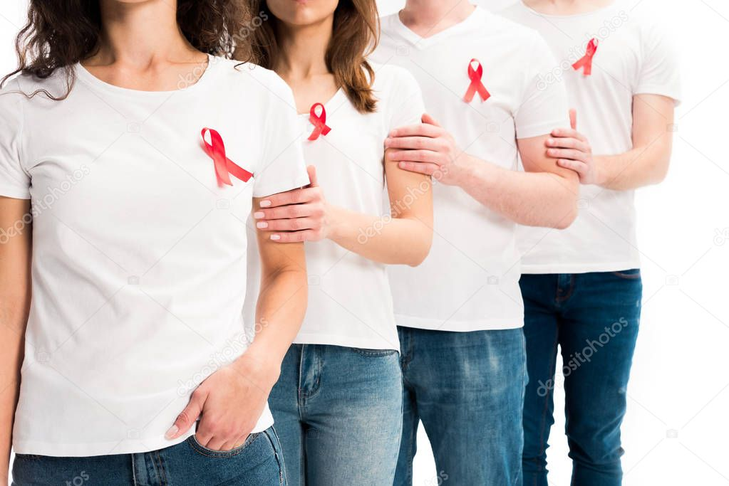 Cropped image of people touching each other and standing with red ribbons on shirts isolated on white, world aids day concept stock vector