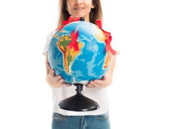 cropped image of woman holding globe with red ribbons isolated on white, world aids day concept