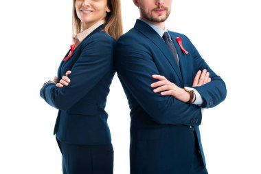 cropped image of businesspeople with red ribbons on suits standing with crossed arms isolated on white, world aids day concept
