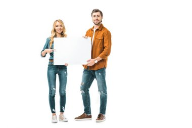 cheerful girl pointing by finger at empty banner while her boyfriend standing near isolated on white