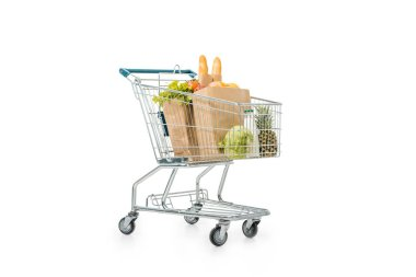 Shopping trolley with paper bags full of products isolated on white stock vector