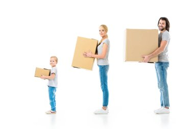 Happy family holding boxes and looking at camera isolated on white