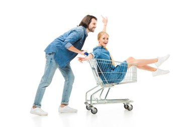 Happy couple having fun with shopping cart isolated on white stock vector