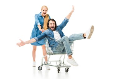 Excited couple laughing and having fun with shopping cart isolated on white stock vector