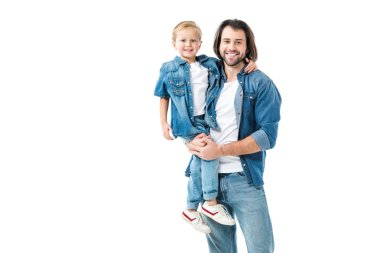 Father and son hugging and smiling at camera isolated on white