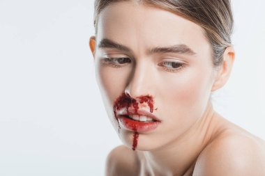 close up of sad wounded woman with blood in face after domestic violence isolated on white