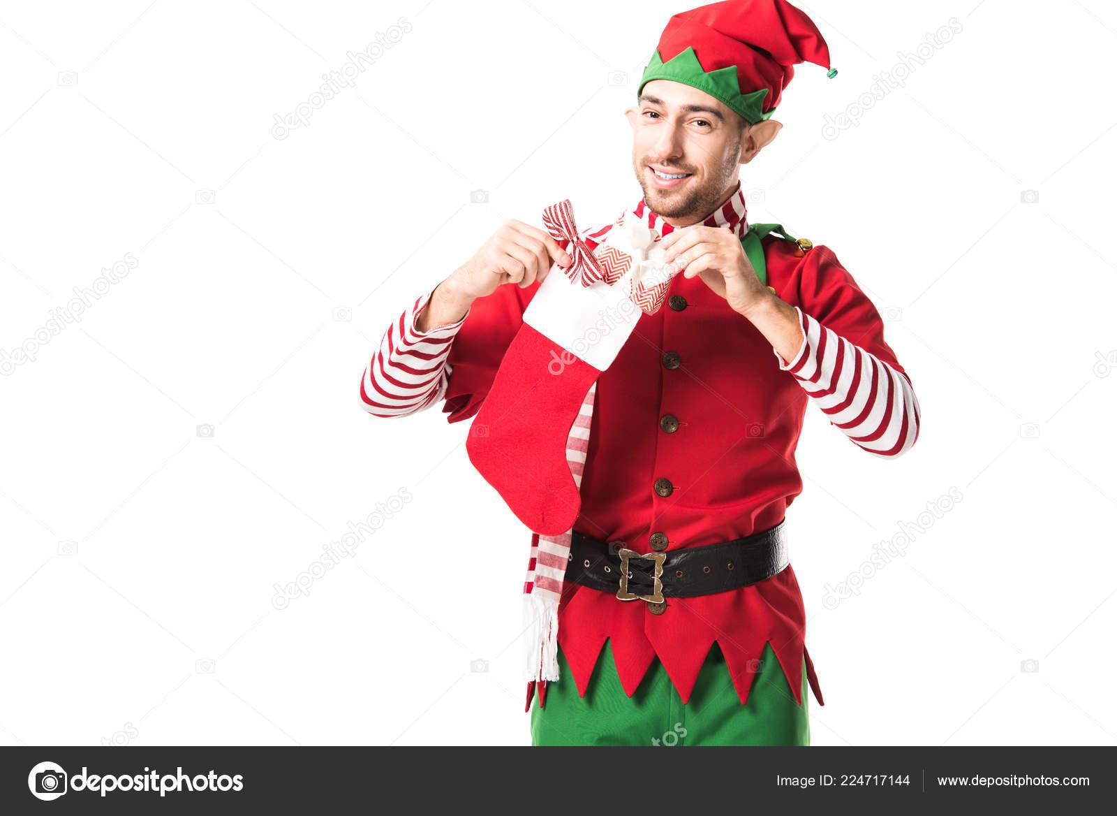 Usmívající Muž Kostýmu Skřítek Vánoční Uvedení Červené Punčochy Při Pohledu  — Stock fotografie 74565af8c1