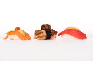 Three nigiri sushi isolated on white