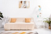 selective focus of modern living room with carpet, sofa and painting on wall