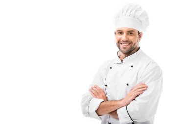 Attractive young chef with crossed arms looking at camera isolated on white stock vector