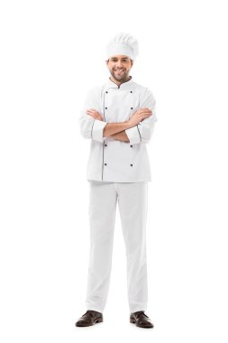 Happy young chef with crossed arms looking at camera isolated on white stock vector