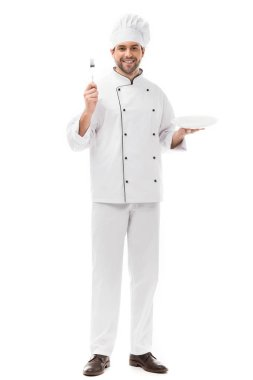 Happy young chef with plate and fork looking at camera isolated on white stock vector