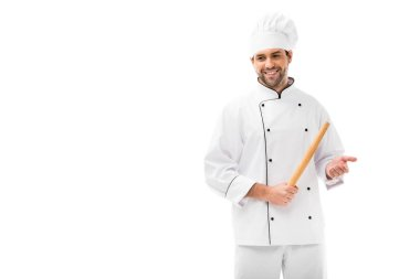 Smiling young chef holding rolling pin and looking away isolated on white stock vector