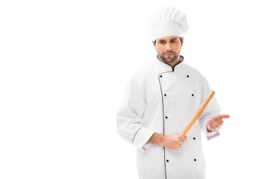 Serious young chef holding rolling pin isolated on white stock vector