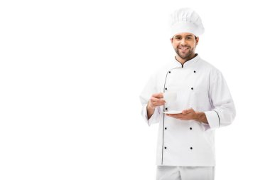 Happy young chef holding cup of coffee and smiling at camera isolated on white stock vector