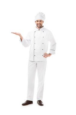 Full length view of young chef showing copy space and smiling at camera isolated on white stock vector