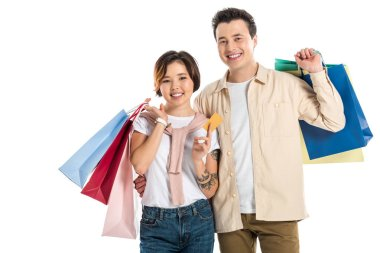 Happy couple holding shopping bags and credit card isolated on white stock vector