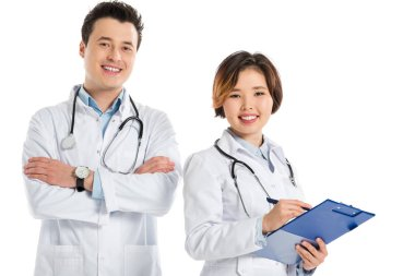 female doctor with diagnosis and male doctor with crossed arms looking at camera isolated on white