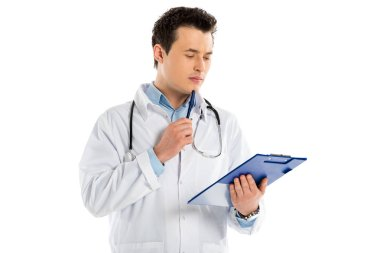 Pensive male doctor holding diagnosis and pen isolated on white stock vector