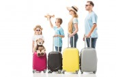 Happy family standing with baggage isolated on white