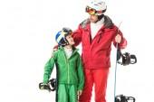 Fotografie Erwachsenen Vater im Ski Anzug umarmen preteen Sohn mit Snowboard isoliert auf weiss