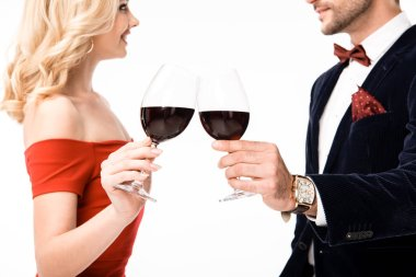 Cropped view of couple clinking glasses of wine isolated on white